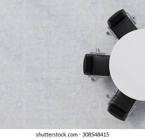 Top view of a half of the conference room. A white round table, three black leather chairs. Office interior. 3D rendering.