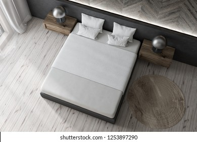 Top view of modern bedroom with wooden and gray walls, wooden floor and gray master bed with white cover and two wooden bedside tables with lamps. 3d rendering