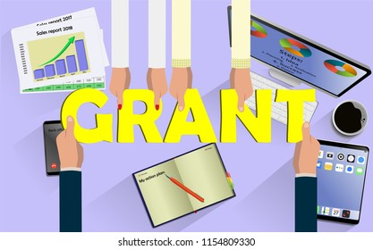 Top view on hands with letters GRANT above desk with laptop,mobile, tablet and other business accessories Modern business workplace
