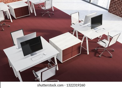 Top view of open space office with brick walls, white floor with red carpet and rows of compact white computer tables with red and white chairs. 3d rendering