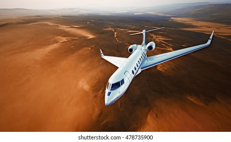 Top View Photo White Luxury Generic Design Airplane.Private Jet Cruising High Altitude, Flying Over Mountains.Empty Blue Sky with Sun Background. Business Travel Concept. Horizontal. 3D rendering