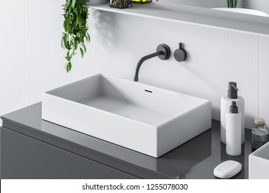 Top view of rectangular white bathroom sink standing on gray countertop in room with white walls and a mirror. 3d rendering