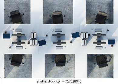 Top view of two rows of white table office cubicles with computers and folders on the desks. A concrete floor. Concept of a start up. 3d rendering mock up