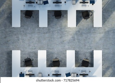 Top view of white table office cubicles with computers and folders on the desks. A concrete floor. Concept of a start up. 3d rendering mock up