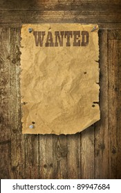 Torn Wild West wanted poster on old wooden wall