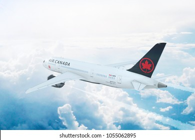 TORONTO, CANADA - MARCH 22, 2018:  Aerial in-flight view of Air Canada Boeing 787 Dreamliner flying high above the clouds. 3D Illustration.