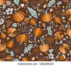 Tossed pattern of pumpkins, acorns, chestnuts, berries and leaves in autumnal color palette