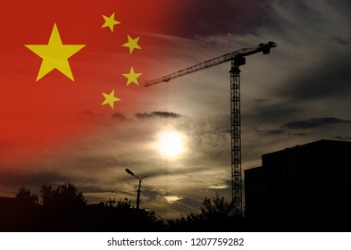 Tower crane against sunset. Chinese economy concept.