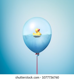 Toy duck on water minimal 3d illustration concept inside balloon. Flying balloon copy space idea with yellow rubber duck on blue background