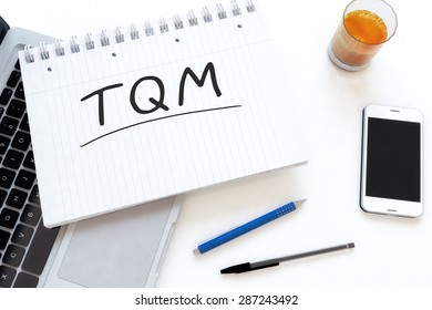 TQM - Total Quality Management - handwritten text in a notebook on a desk - 3d render illustration.
