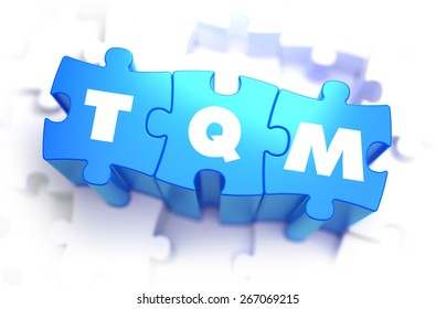 TQM - WWhite Word on Blue Puzzles on White Background. 3D Illustration.