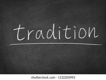 tradition concept word on a blackboard background