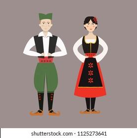 Traditional Balkan Serbian man and woman in Serbian costumes.