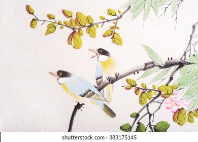Traditional Chinese painting of flowers and two birds on tree