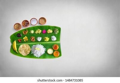 Traditional food Onam Sadya served on a banana leaf on Festival day onam,  Vegetarian meal with rice and curries, kerala food, Kerala, india, illustration