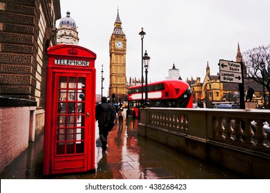 Traditional red telephone box in the rainy day with the Big Ben and red bus in the background. Artistic water colour filter - Palette Knife
