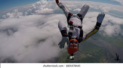 Traffic give five. Skydiver is in free fall. Parachutist uses professional equipment.Extreme people flying in open air.  Freedom as a way of life. Banner hi five.