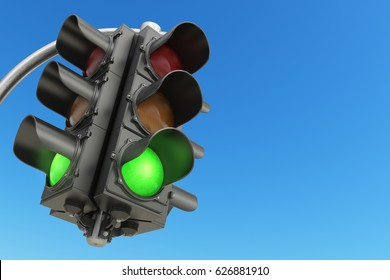 Traffic light with green color on blue sky background. 3d illustration