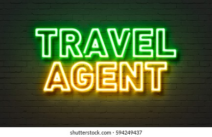 Travel agent neon sign on brick wall background
