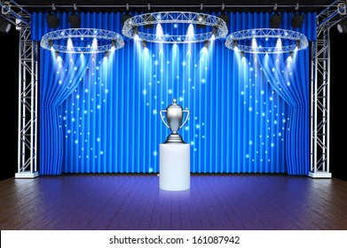 trophy on theater stage blue curtains and spotlights