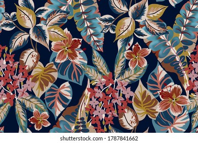 Tropical fabric design seamless pattern vintage composed by exotic flowers and palm leaves with botanical plants on dark blue background.