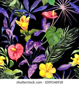 Tropical leaves and exotic flowers in neon light at black background. Seamless summer pattern. Watercolor