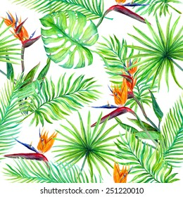 Tropical leaves and exotic flowers. Seamless jungle pattern. Watercolor