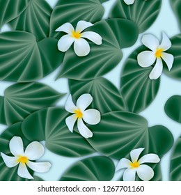 Tropical seamless background with leaves and frigipani