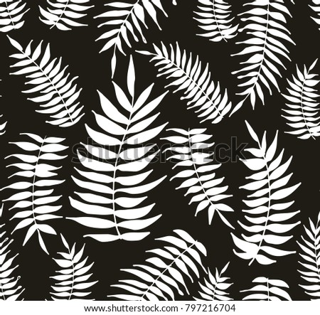 Tropical white palm leaves seamless patter on the dark grey background. It can be used as wrapping paper, wallpaper, textiles and for your own designes.