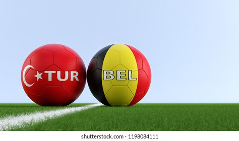 Turkey vs. Belgium Soccer Match - Soccer balls in Turkey and Belgium national colors on a soccer field. Copy space on the right side - 3D Rendering
