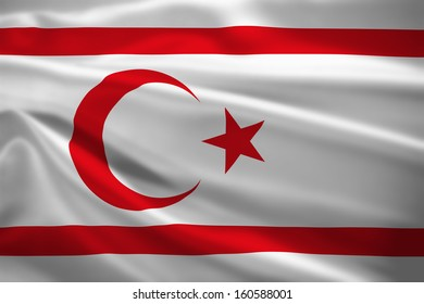 Turkish Republic of Northern Cyprus flag blowing in the wind. Background texture.