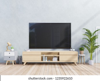 TV on cabinet in modern living room with lamp,table,flower and plant on light Blue wall background,3d rendering