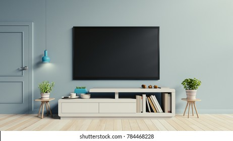 TV on the cabinet in modern living room have plants and book on blue wall background,3d rendering