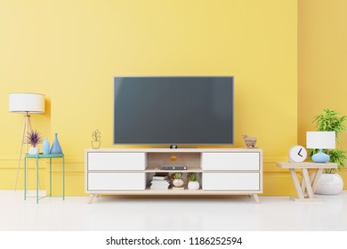 TV on wall with cabinet in modern empty room Include tree,lamp and many decorations on yellow wall background,3d rendering
