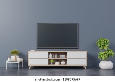 TV on wall with cabinet in modern empty room Include tree,lamp and many decorations on back dark wall background, 3d rendering