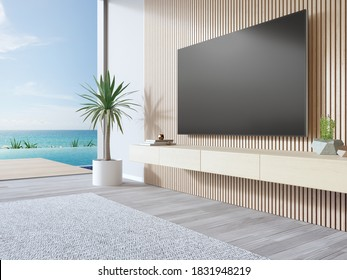 TV on wooden wall of living room in modern beach house or luxury pool villa. White home interior 3d rendering with sea view.