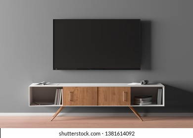 TV screen on the gray wall in modern living room. 3d illustration