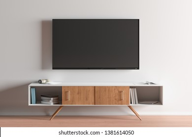 TV screen on the white wall in modern living room. 3d illustration