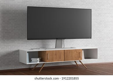 TV wide screen on the TV stand near white brick wall. Side view. 3d illustration