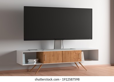 TV wide screen on the TV stand in modern living room with white wall. Side view. 3d illustration