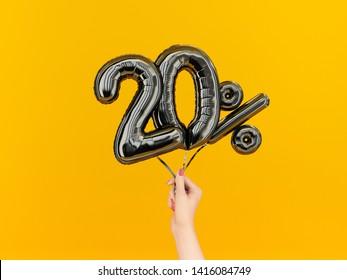 Twenty percent symbol discount. 20 % sale banner black flying foil balloons on yellow. 3d rendering.