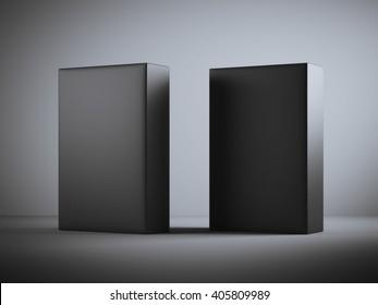 Two blank black boxes in dark studio. 3d rendering