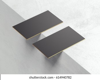 Two blank black business cards with golden sides on the edge. 3d rendering