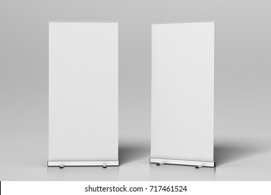 Two blank roll up banner stands isolated on white. Include clipping paths around ad banners. 3d illustration