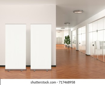 Two blank roll up banner stands in modern office. 3d illustration