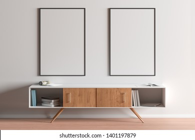Two blank vertical posters mock up with black frame above the cabinet in living room interior. 3d illustration