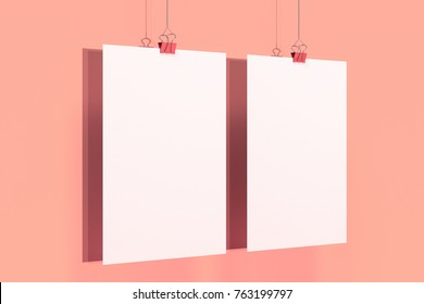 Two blank white posters with binder clip mockup on red background. Poster or paper sheet template. 3D rendering illustration