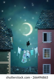 Two cats on a rope are looking at the moon in a town at night