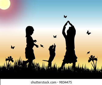 two children and a dog catching butterflies