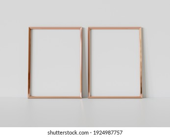 Two golden rectangular frames leaning on white floor in interior mockup. Template of pictures framed on a wall 3D rendering
